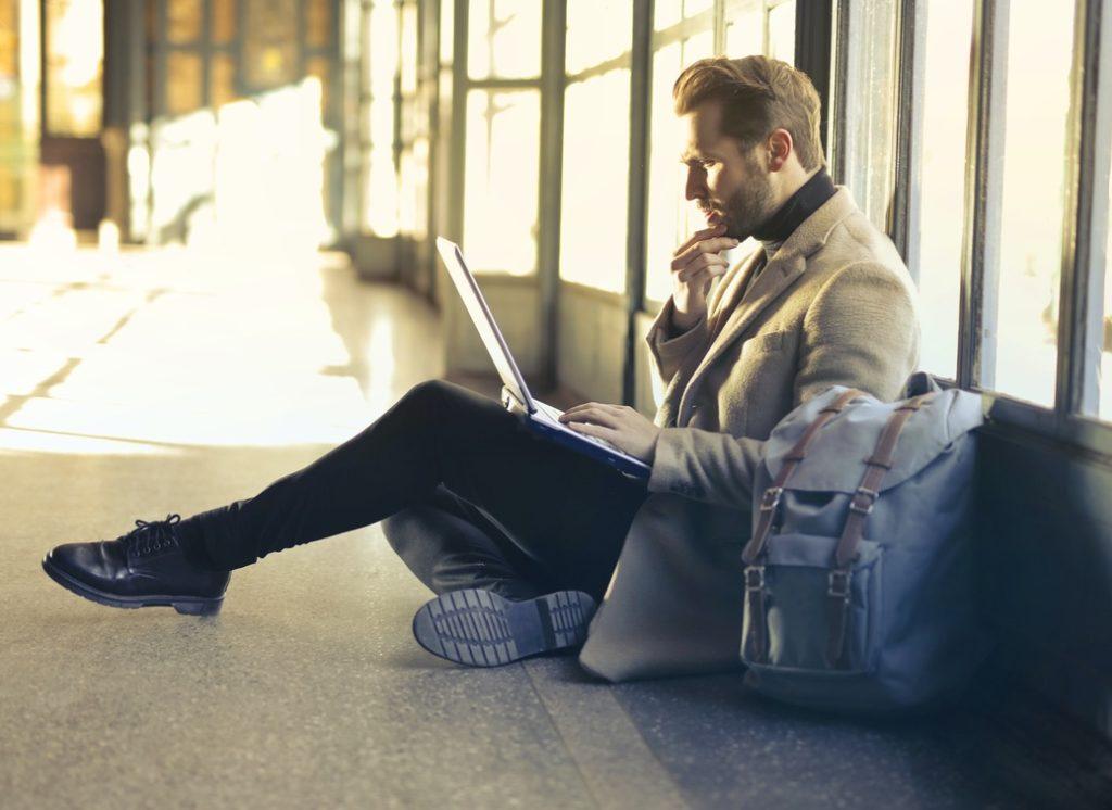 man looking for the LinkedIn Saved Jobs menu