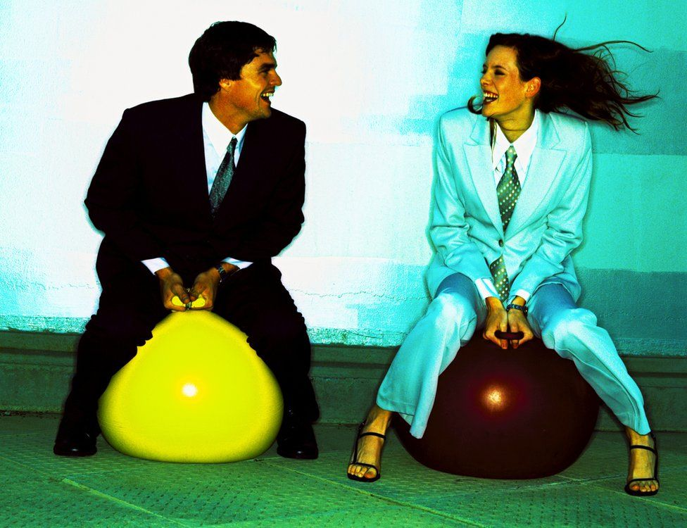 People in suits on space hoppers - to illustrate how 'job hoppers' lead to stale data.